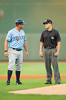 Wilmington Blue Rocks manager Vance Wilson (13) argues a call with base umpire Doug Del Bello during the Carolina League game against the Winston-Salem Dash at BB&T Ballpark on August 3, 2013 in Winston-Salem, North Carolina.  The Blue Rocks defeated the Dash 4-2.  (Brian Westerholt/Four Seam Images)