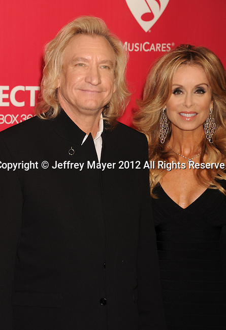 LOS ANGELES, CA - FEBRUARY 10: Joe Walsh and Majorie Walsh arrive at The 2012 MusiCares Person of The Year Gala Honoring Paul McCartney at Los Angeles Convention Center on February 10, 2012 in Los Angeles, California.