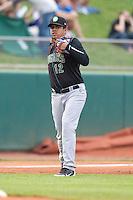 Kane County Cougars third baseman Jeimer Candelario #12 throws during a game against the Cedar Rapids Kernels at Veterans Memorial Stadium on June 8, 2013 in Cedar Rapids, Iowa. (Brace Hemmelgarn/Four Seam Images)