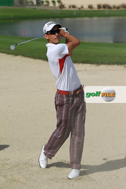 Defending Champion, Rafael Cabrera-Bello (ESP), on the practice ground at the 2013 Omega Dubai Desert Classic held at the EmiratesGolf Club, Dubai, 29th January 2013..Photo Eoin Clarke/www.golffile.ie