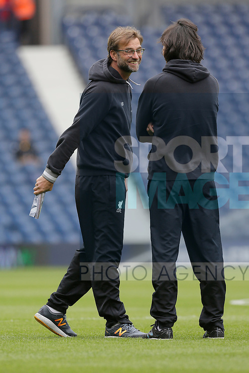 Liverpool manager Jurgen Klopp and assistant Zeljko Buvac look on before the Barclays Premier League match at The Hawthorns.  Photo credit should read: Malcolm Couzens/Sportimage