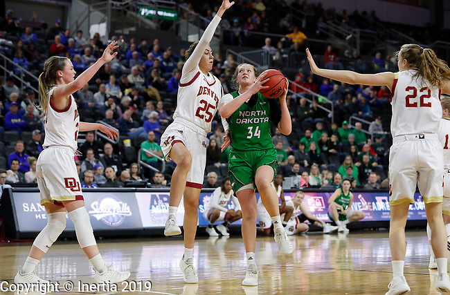 SIOUX FALLS, SD - MARCH 10: Lexi Klabo #34 from North Dakota attempts a layup against Sydney Mech #25 from Denver at the 2019 Summit League Basketball Tournament at the Denny Sanford Premier Center in Sioux Falls. (Photo by Dick Carlson/Inertia)