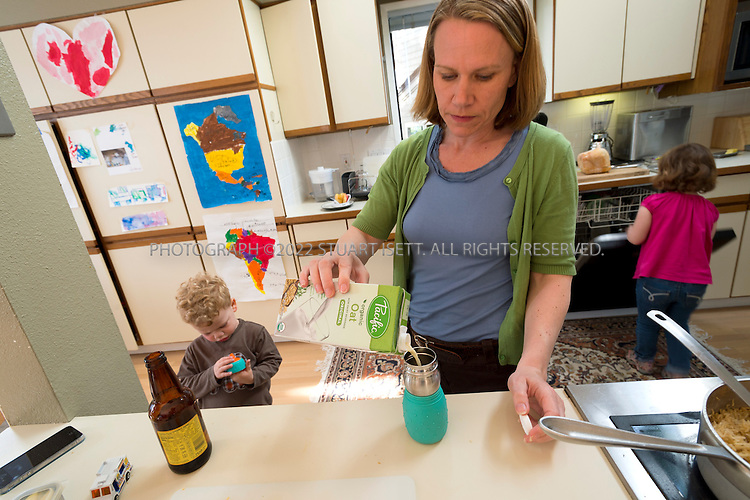 5/29/2012--Seattle, WA, USA..Eric and Eden Mack's twin sons suffer from serious allergies to eggs and nuts. ..Here, Eden Mack pours oat milk for the children, including 4 yr old daughter Addie (right) who has an intolerance for milk...©2012 Stuart Isett. All rights reserved.