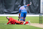 Daniel Pascoe of HKI United (L) jumps to catch off the ball during the Hong Kong T20 Blitz match between Kowloon Cantons and HKI United at Tin Kwong Road Recreation Ground on March 11, 2017 in Hong Kong, Hong Kong. Photo by Chris Wong / Power Sport Images