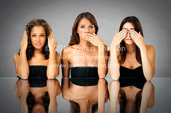 Three Hispanic women with hands over mouth, eyes, ears