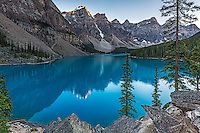The Valley of the Ten Peak peaks reflecting upon the still waters of Moraine Lake in Banff National Park. Many think Lake Louise is the ultimate lake of the Canadian Rockies, I disagree.  The crazy blue color is brought to you by the glacier flour dumped into the lake from the glaciers above.