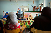 Dr Omaima Kamel, a 51-year-old Muslim Sister, talks to women from Al Saf village assembled at the school to attend her speech. Egypt, June 13th, 2012.