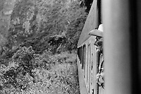 A Mexican cowboy looks at the jungle while standing between the cars of the legendary Chihuahua-Pacífico train in the nothern Mexico, 22 September 1998.