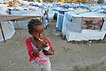 A girl brushes her teeth in a camp for homeless families set up on a golf course in Port-au-Prince, Haiti, which was ravaged by a January 12 earthquake.