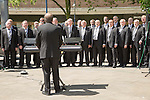Male voice choir performing in Castle Square, Swansea, West Glamorgan, South Wales, UK