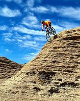 Jeff Haskin, an adrenaline junkie, enjoys slickrock.near Rockville, Utah. (MR)