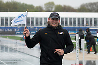 Mizzou senior Reinhard Van Zyl celebrates his victory in the men's javelin with the signature Drake Relays Champion Flag, Friday, April 28. Van Zyl posted a best toss of 66.57 meters/218-5 in the rain at the 108th edition of the Drake Relays in Des Moines, Iowa.