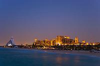 Dubai.  Evening view of the Madinat Jumeirah, Jumeirah Beach Hotel and Mina a?Salam Hotel on Jumeirah Beach. .