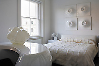 The 1960s white desk in the guest bedroom is by Maurice Calka and the Cloud lamp by Uli Berger