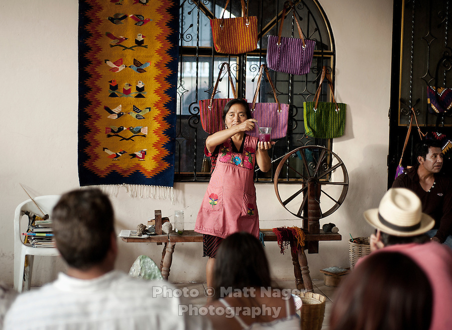 Tourists from Mexico City learn how weavings are dyed and made at a weaving store in Teotitlan del Valle near Oaxaca, Mexico...Photo by Matt Nager
