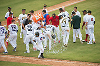 Mesa Solar Sox left fielder Daniel Woodrow (19), of the Detroit Tigers organization, gets a cooler of water emptied on his head after delivering the game winning hit in an Arizona Fall League game against the Peoria Javelinas on October 11, 2018 at Sloan Park in Mesa, Arizona. The Solar Sox defeated the Javelinas 10-9. (Zachary Lucy/Four Seam Images)