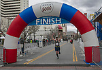 Marathon winner Christopher Robinette crosses the finish line during the 6th Annual Reno 5000 Downtown River Run on Saturday, April 6, 2019.