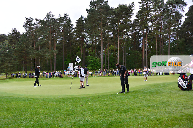 Darren CLARKE (NIR) and Thongchai JAIDEE (THA) during round one of the BMW PGA championship, Wentworth Golf Club, Virginia Waters, London.<br /> Picture: Fran Caffrey www.golffile.ie
