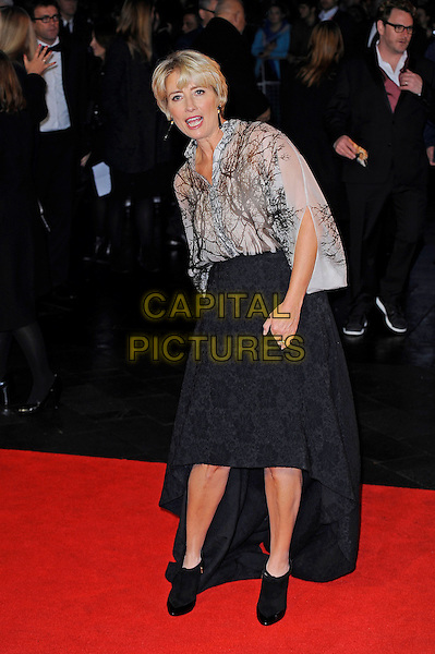 Emma Thompson<br /> attending the 57th BFI London Film Festival Closing Night Gala World Premiere of 'Saving Mr Banks', Odeon Cinema, Leicester Square, London, England. <br /> 20th October 2013<br /> full length black skirt beige white pattern blouse top mouth open train bending leaning <br /> CAP/MAR<br /> &copy; Martin Harris/Capital Pictures