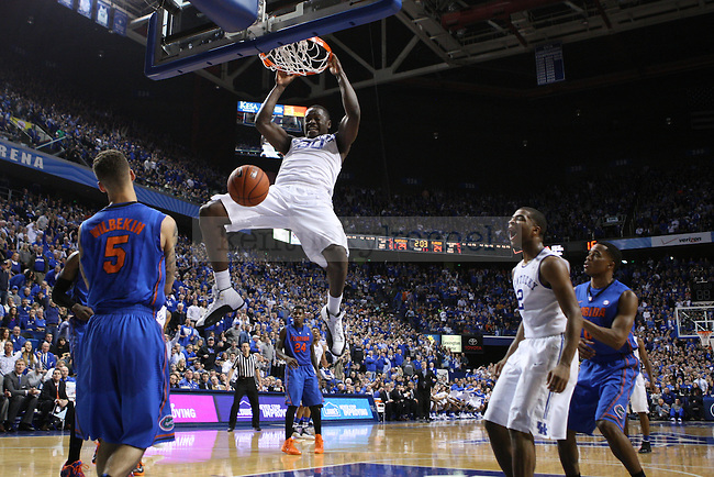 UK forward Julius Randle dunks the ball overtop of Florida guard Scottie Wilbekin while UK guard Aaron Harrison yells in the background during the first half of the UK vs. Florida men's basketball game at Rupp Arena in Lexington, Ky., on Saturday, February, 15, 2014. Photo by Jonathan Krueger | Staff