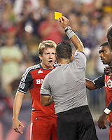 Toronto FC midfielder Terry Dunfield (23) expresses disbelief as he receives yellow card warning. In a Major League Soccer (MLS) match, Toronto FC defeated New England Revolution, 1-0, at Gillette Stadium on July 14, 2012.