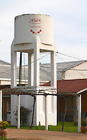 A water tower in the vineyard painted in white and with the winery name on it. Vinedos y Bodega Filgueira Winery, Cuchilla Verde, Canelones, Montevideo, Uruguay, South America