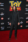 """LOS ANGELES, CALIFORNIA - JUNE 11: Keanu Reeves attends the premiere of Disney and Pixar's """"Toy Story 4"""" on June 11, 2019 in Los Angeles, California.  <br /> CAP/MPIFS<br /> ©MPIFS/Capital Pictures"""