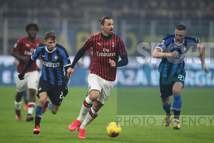 Zlatan Ibrahimovic of AC Milan is pursued by Nicolo Barella and Milan Skriniar of Inter during the Serie A match at Giuseppe Meazza, Milan. Picture date: 9th February 2020. Picture credit should read: Jonathan Moscrop/Sportimage