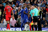 Chelsea's Antonio Rudiger argues with referee, Lee Mason and his Assistant Referee as he blows the whistle for half-time during Chelsea vs Huddersfield Town, Premier League Football at Stamford Bridge on 9th May 2018