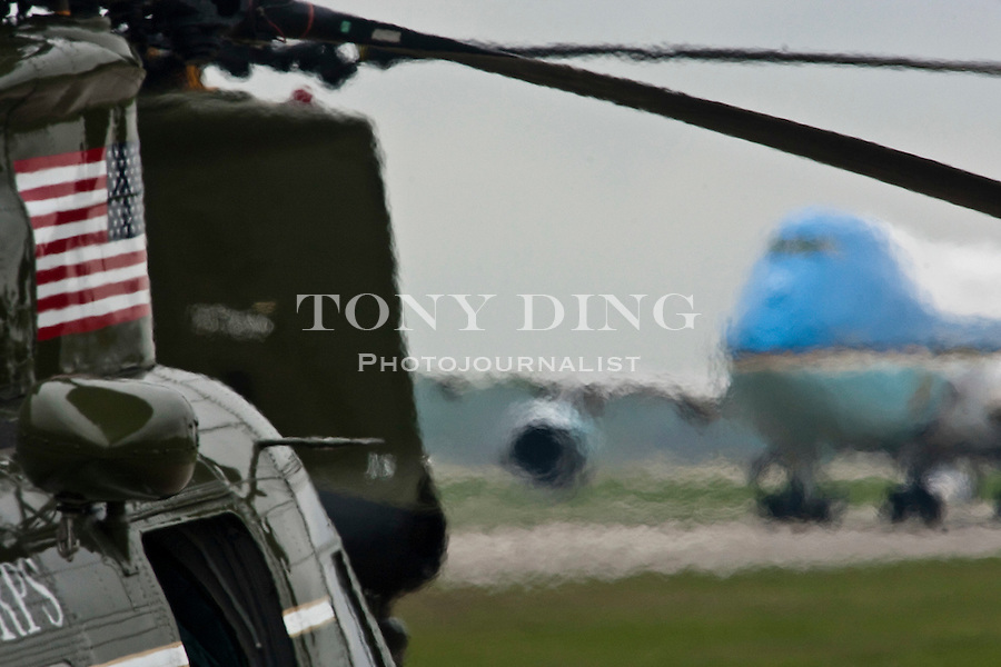 The hot exhaust air from a Marines helicopter distorts the view of Air Force One, with the President aboard, as the plane taxis on the runway at Detroit Metropolitan Airport after arriving from Washington, Saturday, May 1, 2010, in Romulus, Mich. President Obama. (AP Photo/Tony Ding)