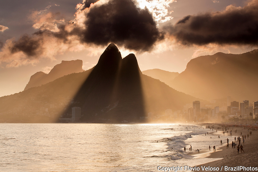 Ipanema and Leblon beaches at sunset, Morro Dois Irmãos ( Dois Irmaos Mountain or Two Brothers Mountain ) and Pedra da Gavea in background. Rio de Janeiro, Brazil.
