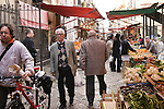 People at outdoor food market. Sicily, Italy