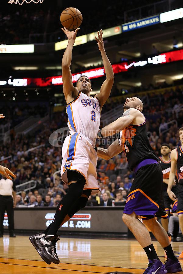 Feb. 10, 2013; Phoenix, AZ, USA: Oklahoma City Thunder guard Thabo Sefolosha (2) drives to the basket in the second quarter against the Phoenix Suns at the US Airways Center. Mandatory Credit: Mark J. Rebilas-
