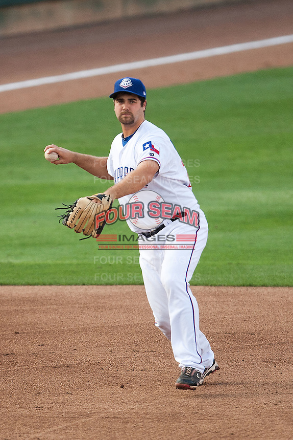 Round Rock Express third baseman Tommy Mendonca #24 throws the ball to first base during the MLB exhibition baseball game against the Texas Rangers on April 2, 2012 at the Dell Diamond in Round Rock, Texas. The Rangers out-slugged the Express 10-8. (Andrew Woolley / Four Seam Images).
