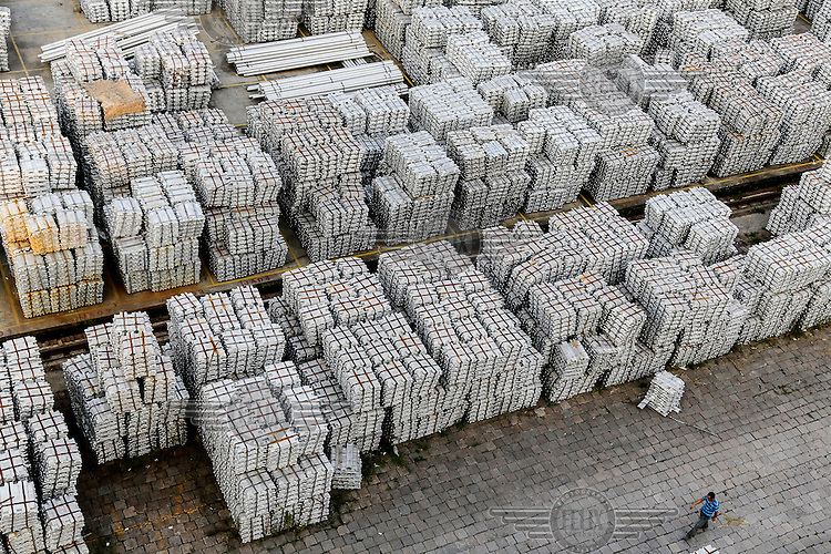 A stockyard filled with aluminum ingots in Wuxi. China is faced with an over capacity in its production of raw material such as steel and aluminum, as a result of its massive economic stimulus package in 2009, many local governments encouraged the expansion of heavy industries which has created a huge glut in raw material as China's economy begins to slow down.