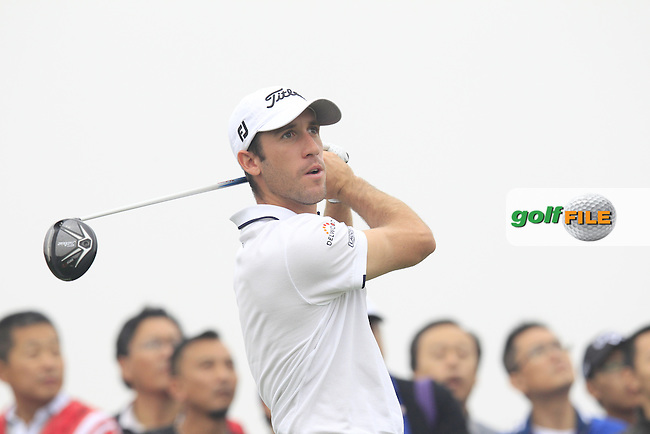 Romain Wattel (FRA) tees off the 15th tee during Saturay's Round 3 of the 2014 BMW Masters held at Lake Malaren, Shanghai, China. 1st November 2014.<br /> Picture: Eoin Clarke www.golffile.ie
