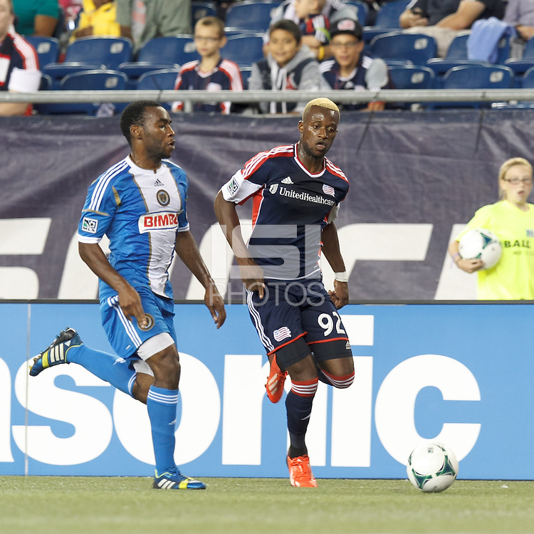 New England Revolution substitute forward Dimitry Imbongo (92) dribbles down the wing. In a Major League Soccer (MLS) match, the New England Revolution (dark blue) defeated Philadelphia Union (light blue), 5-1, at Gillette Stadium on August 25, 2013.