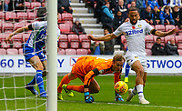 Leeds United's Kemar Roofe steals the ball from Wigan Athletic's Christian Walton before slotting the wining goal<br /> <br /> Photographer Alex Dodd/CameraSport<br /> <br /> The EFL Sky Bet Championship - Wigan Athletic v Leeds United - Sunday 4th November 2018 - DW Stadium - Wigan<br /> <br /> World Copyright &copy; 2018 CameraSport. All rights reserved. 43 Linden Ave. Countesthorpe. Leicester. England. LE8 5PG - Tel: +44 (0) 116 277 4147 - admin@camerasport.com - www.camerasport.com