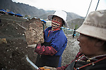 Tibetans searching for holy prayer stones that the chinese used as foundations for several buildings in the city.