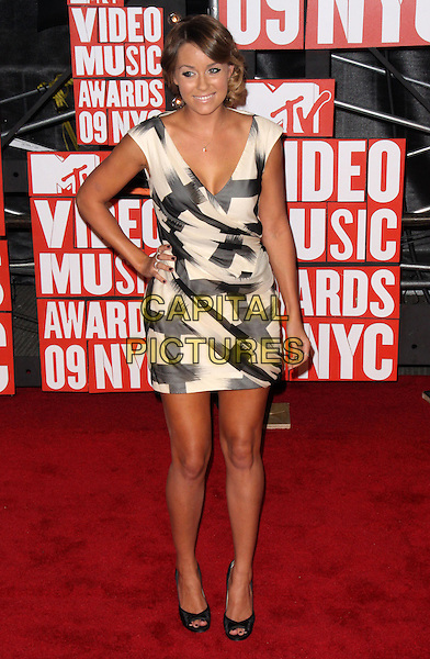 LAUREN CONRAD .2009 MTV Video Music Awards arrivals held at Radio City Music Hall, New York, NY, USA..September 13th, 2009.full length black beige sleeveless pattern dress hand on hip.CAP/ADM/PZ.©Paul Zimmerman/AdMedia/Capital Pictures.
