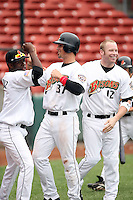 June 28th 2008:  Jason Cooper of the Buffalo Bisons, Class-AAA affiliate of the Cleveland Indians, is congratulated by Chris De La Cruz and Jordan Brown after scoring the game winning run during a game at Dunn Tire Park in Buffalo, NY.  Photo by:  Mike Janes/Four Seam Images