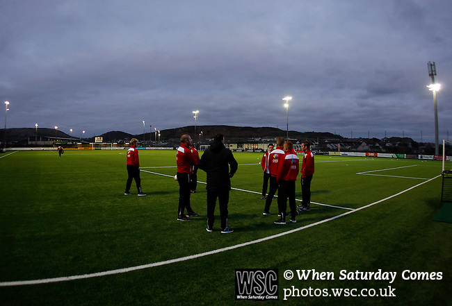 Llandudno 2 Denbigh Town 2, 20/03/2015. Maesdu Park, Huws Gray Alliance Football League. Denbigh Town players get a feel for the pitch. Needing a win to guarantee promotion to the top division of Welsh football for the first time, Llandudno took the lead twice, but were held to a draw against Denbigh Town.<br /> Llandudno installed an artificial 3G pitch in 2014. The pitch is available for hire, and enables to club to have an active community programme, and teams in every age range, all playing at Maesdu Park. Photo by Paul Thompson.