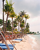 SINGAPORE, Asia, view of a beautiful Siloso beach with palm tree lined at Sentosa Island