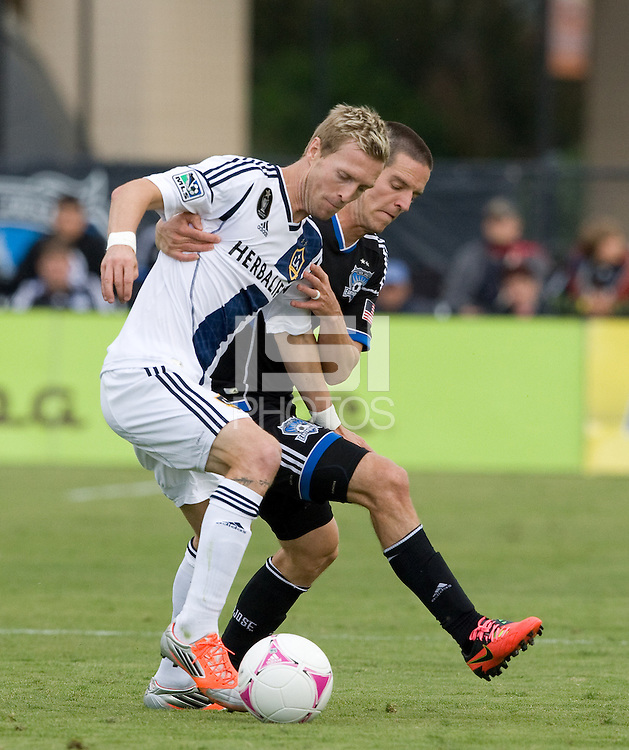 Sam Cronin of Earthquakes fights for the ball against Christian Wilhelmsson of Galaxy at Buck Shaw Stadium in Santa Clara, California on October 21st, 2012.  San Jose Earthquakes and Los Angeles Galaxy tied at 2-2.