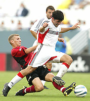 26 June 2004:  DC United Forward Alecko Eskandarian dribbles the ball away from against Dallas Burn Midfielder Brad Davis at Cotton Bowl in Dallas, Texas.   DC United and Dallas Burn are tied 1-1 after the game.   Credit: Michael Pimentel / ISI