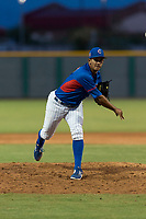 AZL Cubs 2 relief pitcher Elias Herrera (67) follows through on his delivery during an Arizona League game against the AZL White Sox at Sloan Park on July 13, 2018 in Mesa, Arizona. The AZL Cubs 2 defeated the AZL White Sox by a score of 6-4. (Zachary Lucy/Four Seam Images)