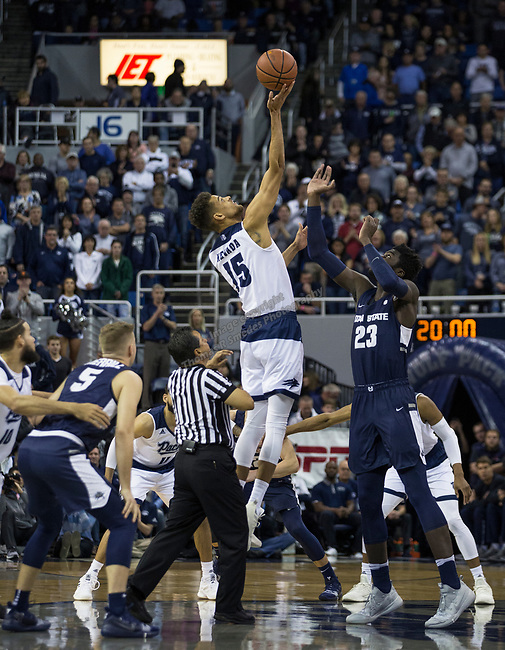 Nevada forward Trey Porter (15) get the tip at the start of their game against Utah State in Reno, Nev., Wednesday, Jan. 2, 2019. (AP Photo/Tom R. Smedes)