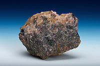 Gadolinite with fluorite. Gadolinite is a complex silicate mineral which is a source of rare earth elements, particularly yttrium. Fluorite is associated with many of the rare earth bearing pegmatites in Colorado. Teller Pegmatite, Lake George Park County, Colorado, USA