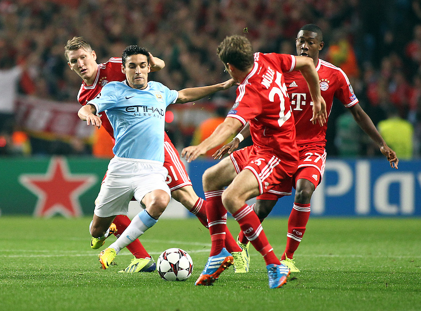 Manchester City's Jesus Navas under pressure from Bayern Munich's David Alaba (right) Thomas Muller (centre) and Toni Kroos (left)<br /> <br /> Photo by Rich Linley/CameraSport<br /> <br /> Football - UEFA Champions League Group D - Manchester City v Bayern Munich - Wednesday 2nd October 2013 -  Etihad Stadium - Manchester<br /> <br /> &copy; CameraSport - 43 Linden Ave. Countesthorpe. Leicester. England. LE8 5PG - Tel: +44 (0) 116 277 4147 - admin@camerasport.com - www.camerasport.com