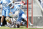 DURHAM, NC - APRIL 30: Notre Dame's Mikey Wynne (below) puts the ball in the net past UNC's Brian Balkam (30), but the goal as waived off as the referee judged Balkam had fouled Wynne prior to the shot. The University of North Carolina Tar Heels played the University of Notre Dame Fighting Irish on April 30, 2017, at Koskinen Stadium in Durham, NC in a 2017 ACC Men's Lacrosse Tournament Championship match. UNC won the game 14-10.